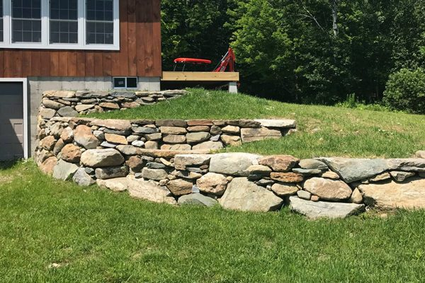 A stone retaining wall at a newly constructed home.